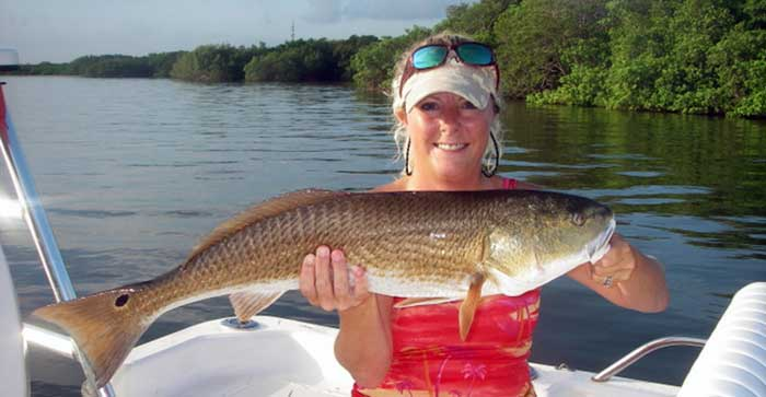 fishing charters client in tampa bay with big redfish